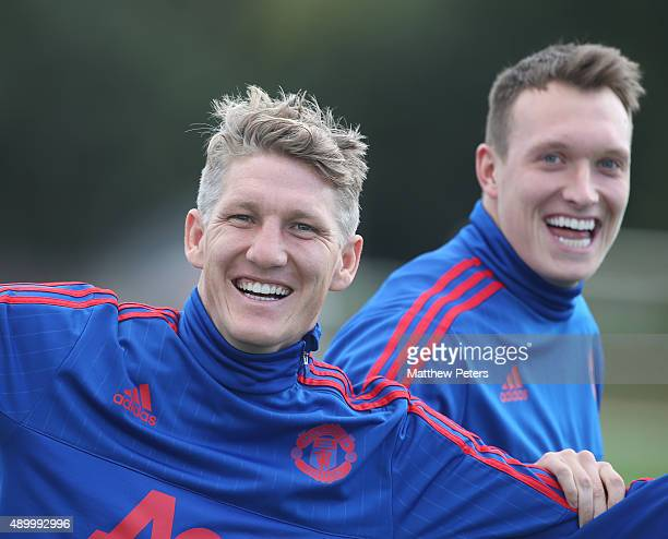 Bastian Schweinsteiger and Phil Jones of Manchester United in action during a first team training session at Aon Training Complex on September 25...