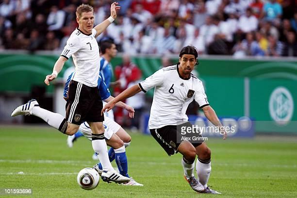 Bastian Schweinsteiger and Sami Khedira of Germany run with the ball during the international friendly match between Germany and Bosnia-Herzegovina...