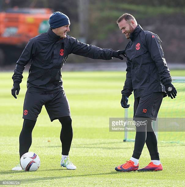 Bastian Schweinsteiger and Wayne Rooney of Manchester United in action during a first team training session at Aon Training Complex on November 23,...