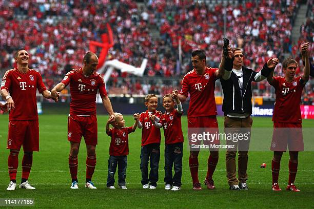 Bastian Schweinsteiger Arjen Robben and his son Luka Miroslav Klose with his twins Luan and Noah 3rd goalkeeper Rouven Sattelmaier and Philipp Lahm...
