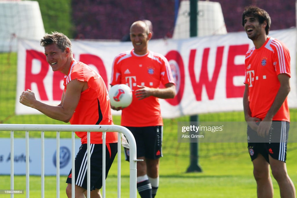 Bastian Schweinsteiger, Arjen Robben and Javier Martinez (L-R) react during a Bayern Muenchen training session at the ASPIRE Academy for Sports Excellence on January 6, 2013 in Doha, Qatar.