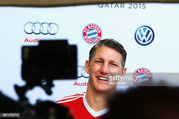 Bastian Schweinsteiger attends a press conference during day 4 of the Bayern Muenchen training camp at ASPIRE Academy for Sports Excellence on...