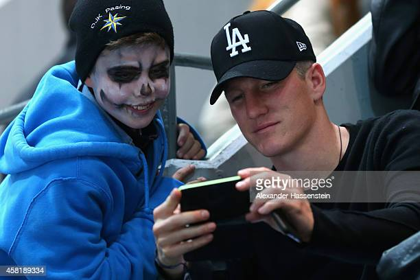 Bastian Schweinsteiger attends the DEL Ice Hockey match between EHC Red Bull Muenchen and Krefeld Pinguine at Olympia Eishalle on October 31, 2014 in...