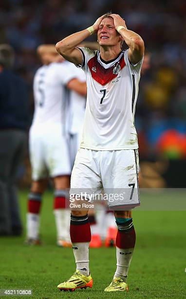 Bastian Schweinsteiger celebrates defeating Argentina 10 in the 2014 FIFA World Cup Brazil Final match between Germany and Argentina at Maracana on...