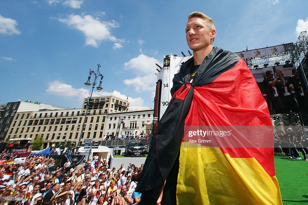 Bastian Schweinsteiger celebrates on stage at the German team victory ceremony July 15, 2014 in Berlin, Germany. Germany won the 2014 FIFA World Cup Brazil match against Argentina in Rio de Janeiro on July 13.