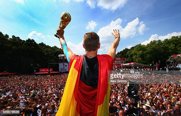 Bastian Schweinsteiger celebrates on stage at the German team victory ceremony July 15, 2014 in Berlin, Germany. Germany won the 2014 FIFA World Cup...