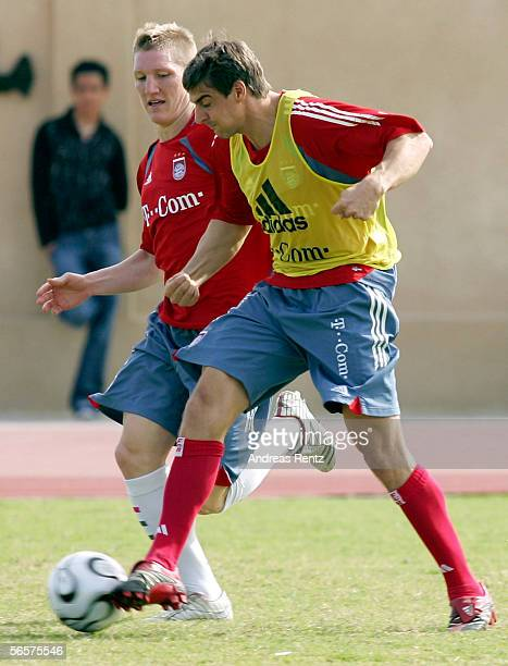 Bastian Schweinsteiger challenges for the ball with Sebastian Deisler of Bayern Munich at their training camp on January 12 2006 in Dubai United Arab...
