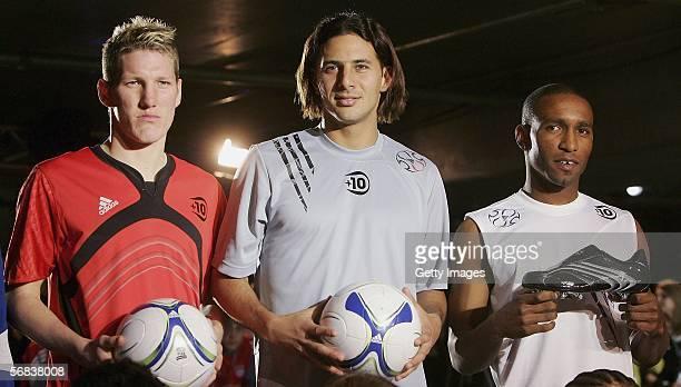 Bastian Schweinsteiger Claudio Pizarro and Jermain Defoe posing during the Major adidas F50 Tunit Launch Event on February 13 2006 in Munich
