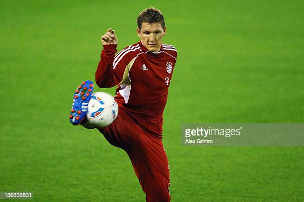 Bastian Schweinsteiger controles the ball during a training session of Bayern Muenchen at the ASPIRE Academy for Sports Excellence on January 2 2012...