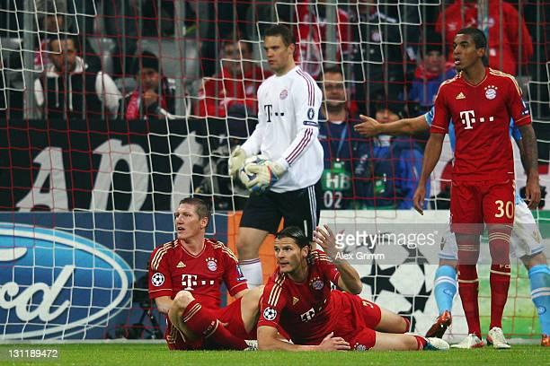 Bastian Schweinsteiger goalkeeper Manuel Neuer Daniel van Buyten and Luiz Gustavo of Muenchen react after Federico Fernandez of Napoli scored his...