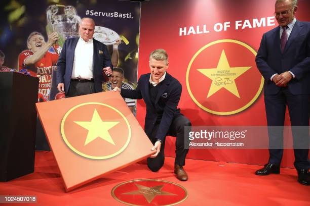 Bastian Schweinsteiger is admitted in the FC Bayern Muenchen Hall of Fame next to Uli Hoeness President of FC Bayern Muenchen and CEO KarlHeinz...