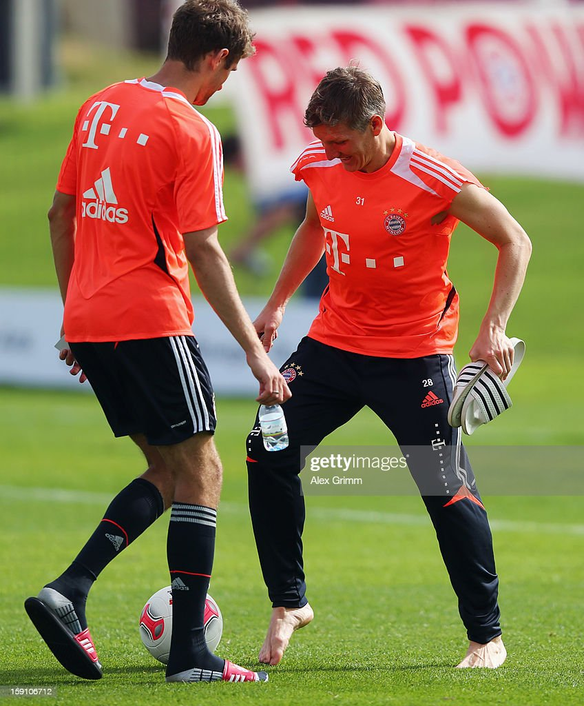 Bastian Schweinsteiger (R) is challenged by Thomas Mueller after a Bayern Muenchen training session at the ASPIRE Academy for Sports Excellence on January 8, 2013 in Doha, Qatar.