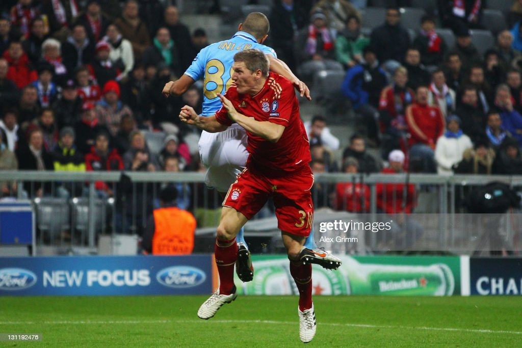 Bastian Schweinsteiger (front) is hurt by Goekhan Inler of Napoli during the UEFA Champions League group A match between FC Bayern Muenchen and SSC Napoli at Allianz Arena on November 2, 2011 in Munich, Germany.