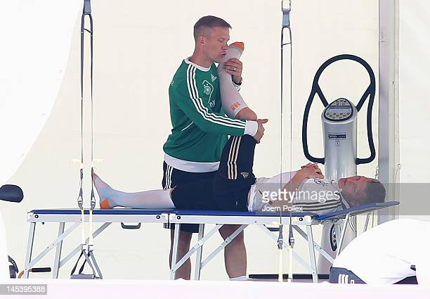 Bastian Schweinsteiger is seen with fitness coach Darcey Norman during a Germany training session at Stadium Tourrettes on May 28 2012 in Tourrettes...