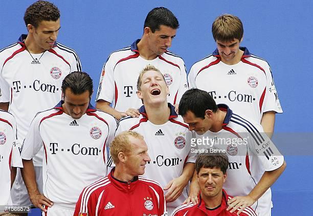 Bastian Schweinsteiger laughs during the Bundesliga 1st Team Presentation of FC Bayern Munich at Bayern's training ground Saebener Strasse on August...