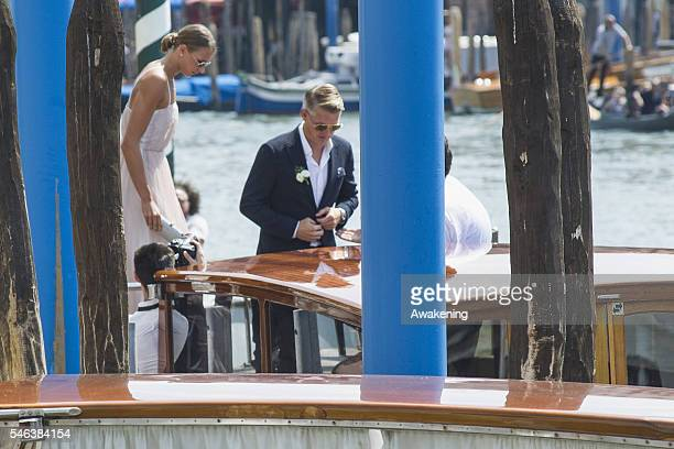 Bastian Schweinsteiger leaves the Aman Grand Canal hotel to reach the wedding hall at Palazzo Cavalli before the celebration of their marriage on...