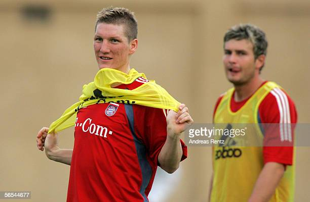 Bastian Schweinsteiger looks on during a fitness training session of Bayern Munich at the club's training camp on January 9 2006 in Dubai United Arab...