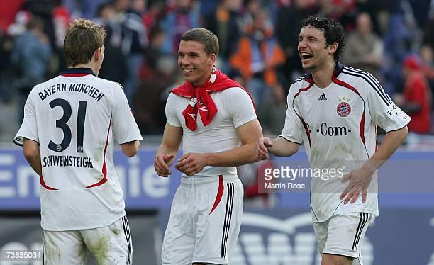Bastian Schweinsteiger Lukas Podolski and Mark van Bommel celebrate after the Bundesliga match between Hanover 96 and Bayern Munich at the AWD Arena...