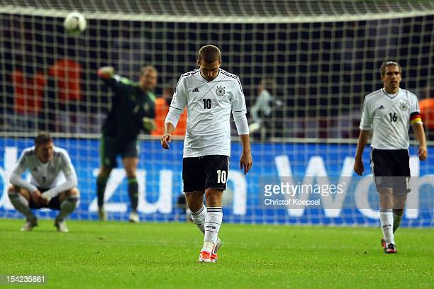 Bastian Schweinsteiger Manuel Neuer Lukas Podolski and Philipp Lahmof Germany look dejected afetre the forth goal of Sweden during the FIFA 2014...