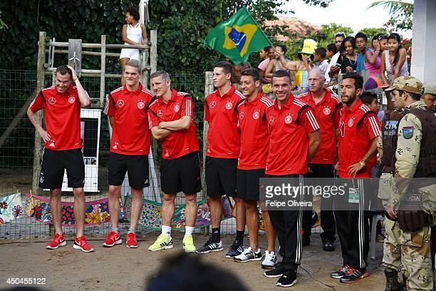 Bastian Schweinsteiger Mesut Ozil Lukas Podolski Julian Draxler Kevin Grosskreutz and Matthias Ginter of the Germany national football team visit the...