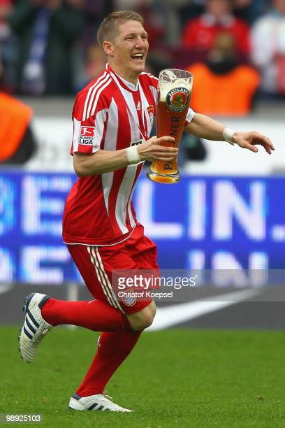 Bastian Schweinsteiger of Bayern celebrates winning the German Champions trophy after the 31 of the Bundesliga match between Hertha BSC Berlin and FC...