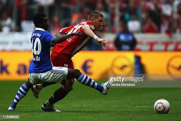 Bastian Schweinsteiger of Bayern is challenged by Anthony Annan of Schalke during the Bundesliga match between FC Bayern Muenchen and FC Schalke 04...