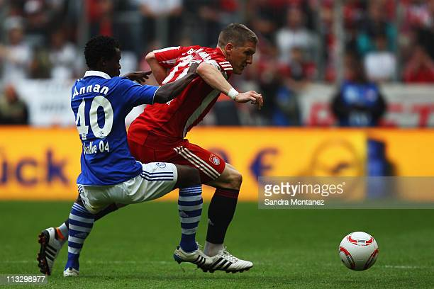 Bastian Schweinsteiger of Bayern is challenged by Anthony Annan of Schalke during the Bundesliga match between FC Bayern Muenchen and FC Schalke 04...