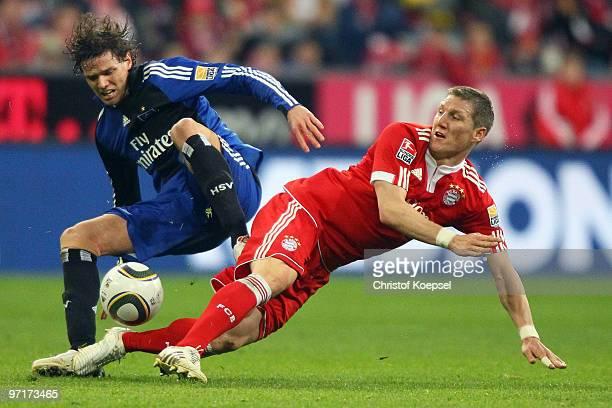 Bastian Schweinsteiger of Bayern is challenged by Marcus Berg of Hamburg during the Bundesliga match between FC Bayern Muenchen and Hamburger SV at...
