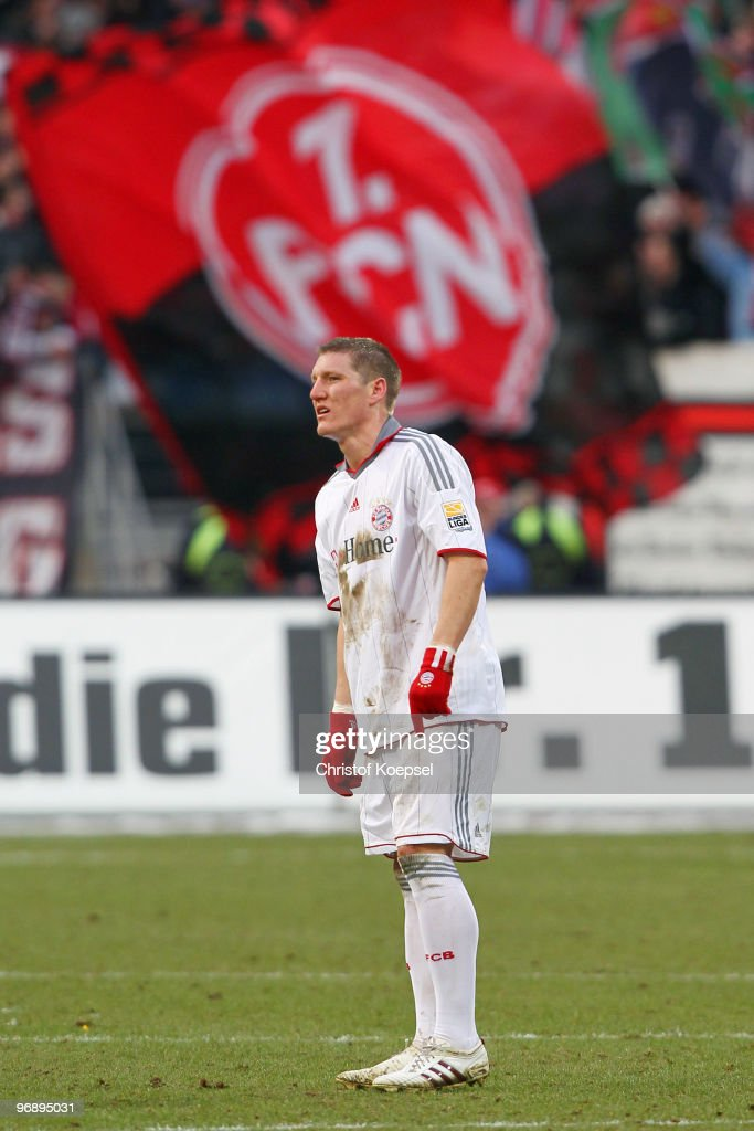 Bastian Schweinsteiger of Bayern looks dejected after the 1-1 draw of the Bundesliga match between 1. FC Nuernberg and FC Bayern Muenchen at Easy Credit Stadium on February 20, 2010 in Nuremberg, Germany.