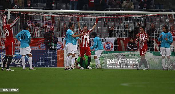 Bastian Schweinsteiger of Bayern Muenchen and his team mate Mario Gomez celebrate the second team goal during the UEFA Champions League group E match...