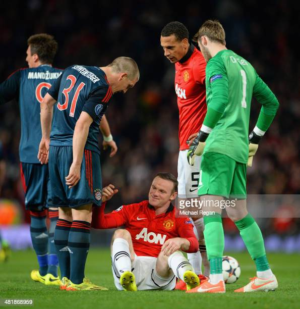 Bastian Schweinsteiger of Bayern Muenchen argues with Wayne Rooney of Manchester United after he received a red card during the UEFA Champions League...