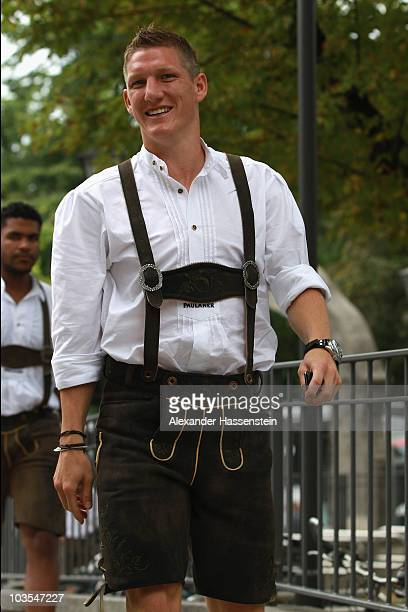Bastian Schweinsteiger of Bayern Muenchen arrives for the Paulaner photocall at the Nockerberg Biergarden on August 23 2010 in Munich Germany