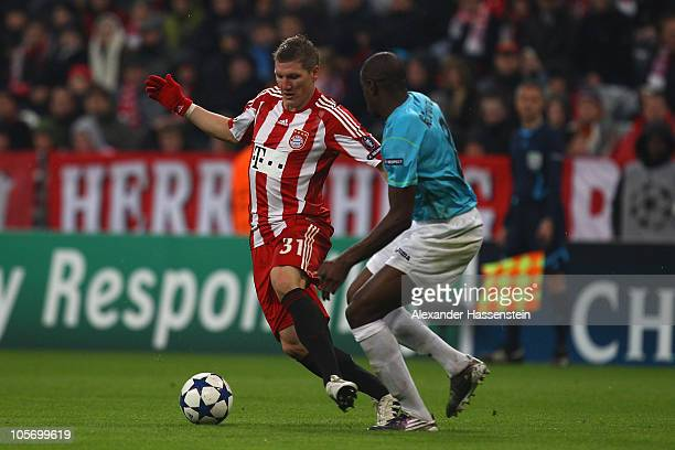 Bastian Schweinsteiger of Bayern Muenchen battles for the ball with Lacina Traore of Cluj during the UEFA Champions League group E match between FC...