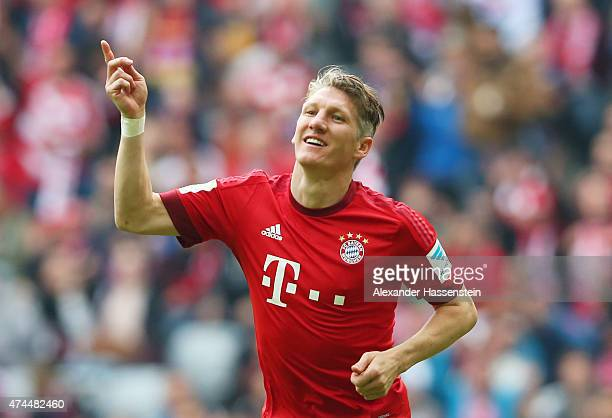 Bastian Schweinsteiger of Bayern Muenchen celebrates after scoring his team's second goal during the Bundesliga match between FC Bayern Muenchen and...