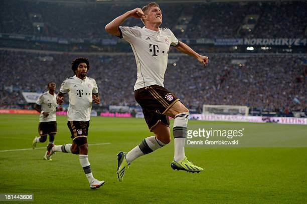 Bastian Schweinsteiger of Bayern Muenchen celebrates his team's first goal during the Bundesliga match between FC Schalke 04 and FC Bayern Muenchen...