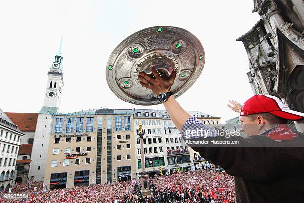 Bastian Schweinsteiger of Bayern Muenchen celebrates the German championship title on the balcony of the town hall on May 9 2010 in Munich Germany