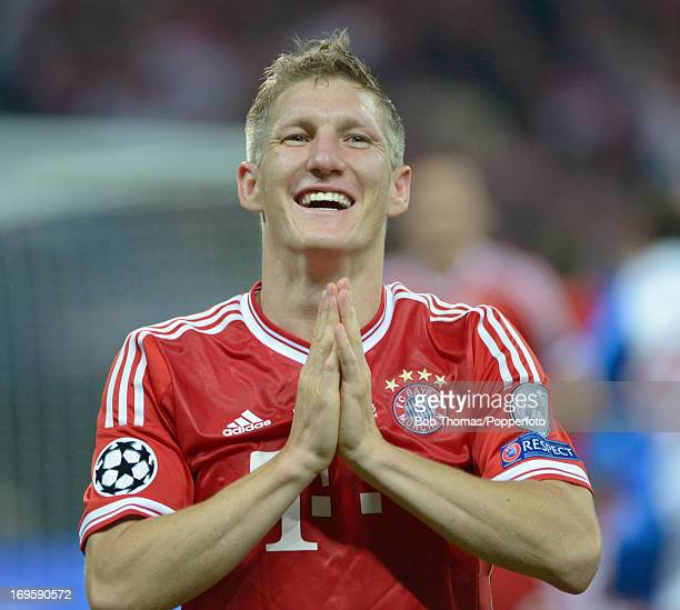 Bastian Schweinsteiger of Bayern Muenchen celebrates victory after the UEFA Champions League final match between Borussia Dortmund and FC Bayern...