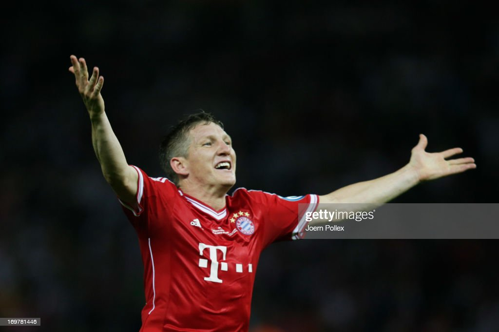 Bastian Schweinsteiger of Bayern Muenchen celebrates victory