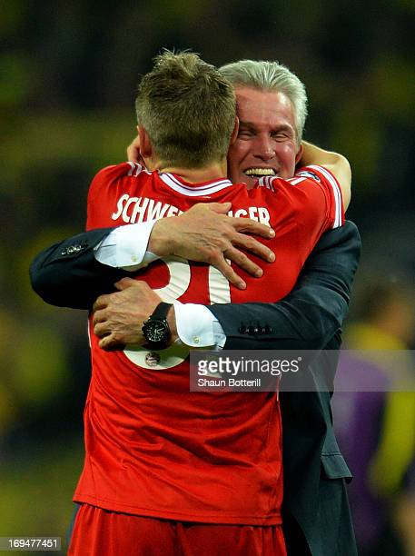 Bastian Schweinsteiger of Bayern Muenchen celebrates with Head Coach Jupp Heynckes of Bayern Muenchen after winning the UEFA Champions League Final...