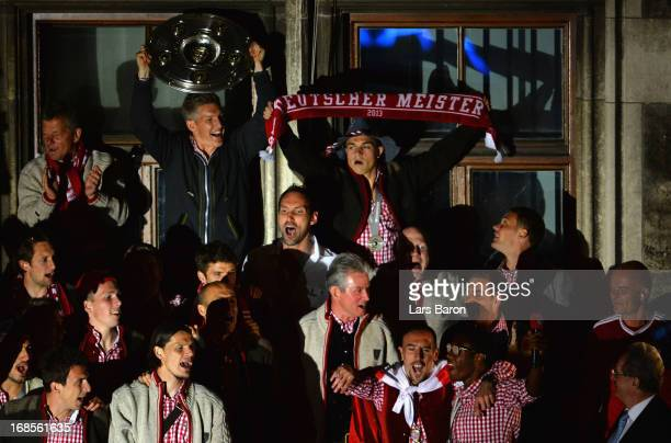Bastian Schweinsteiger of Bayern Muenchen celebrates with team mates the German championship title on the town hall balcony at Marienplatz on May 11,...