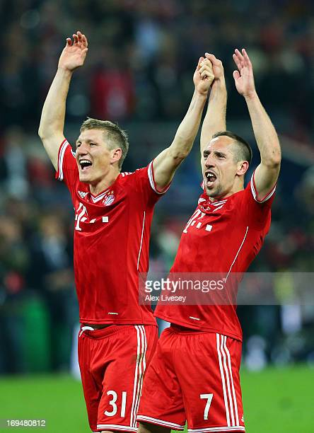 Bastian Schweinsteiger of Bayern Muenchen celebrates with teammate Franck Ribery after winning the UEFA Champions League Final against Borussia...