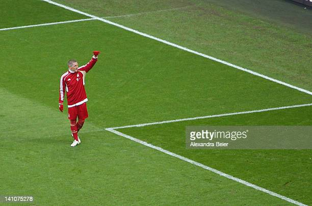 Bastian Schweinsteiger of Bayern Muenchen gives a thumb up to the fans during the warmup for the Bundesliga match between FC Bayern Muenchen and 1899...