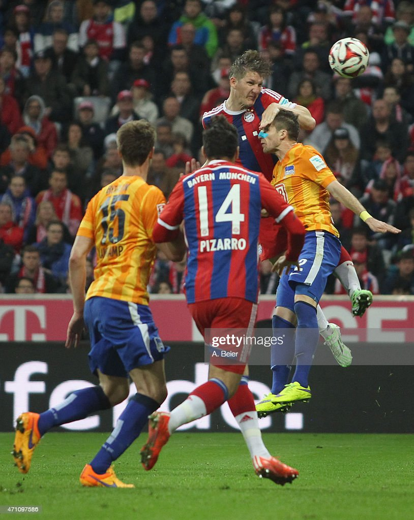 Bastian Schweinsteiger (top) of Bayern Muenchen in action against Peter Pekarik (R) of Hertha BSC during the Bundesliga match between FC Bayern Muenchen and Hertha BSC at Allianz Arena on April 25, 2015 in Munich, Germany.