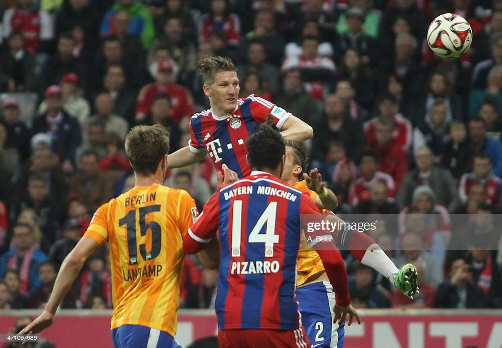 Bastian Schweinsteiger (top) of Bayern Muenchen in action during the Bundesliga match between FC Bayern Muenchen and Hertha BSC at Allianz Arena on April 25, 2015 in Munich, Germany.