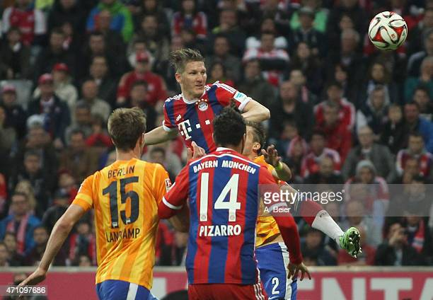 Bastian Schweinsteiger of Bayern Muenchen in action during the Bundesliga match between FC Bayern Muenchen and Hertha BSC at Allianz Arena on April...