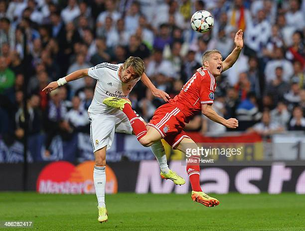 Bastian Schweinsteiger of Bayern Muenchen is challenged by Fabio Coentrao of Real Madrid during the UEFA Champions League semifinal first leg match...