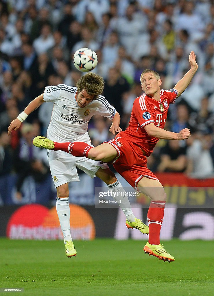 Bastian Schweinsteiger of Bayern Muenchen is challenged by Fabio Coentrao of Real Madrid during the UEFA Champions League semi-final first leg match between Real Madrid and FC Bayern Muenchen at the Estadio Santiago Bernabeu on April 23, 2014 in Madrid, Spain.