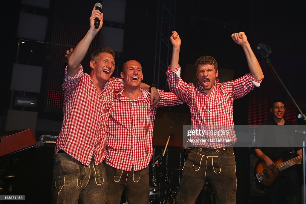 Bastian Schweinsteiger of Bayern Muenchen performes with his team mates Arjen Robben and Thomas Mueller live on stage during the Official Champion dinner at Postpalast on May 12, 2013 in Munich, Germany.