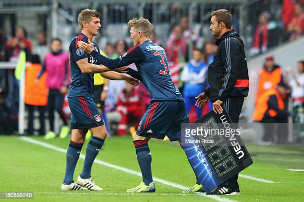 Bastian Schweinsteiger of Bayern Muenchen replaces Toni Kroos as a substitute during the UEFA Champions League Group D match between Bayern Muenchen...