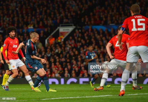 Bastian Schweinsteiger of Bayern Muenchen scores their first goal during the UEFA Champions League Quarter Final first leg match between Manchester...